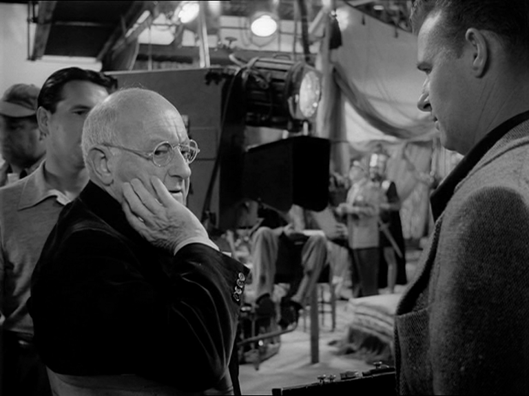 Director Cecil B. Demille  setting the the scene with the camera
