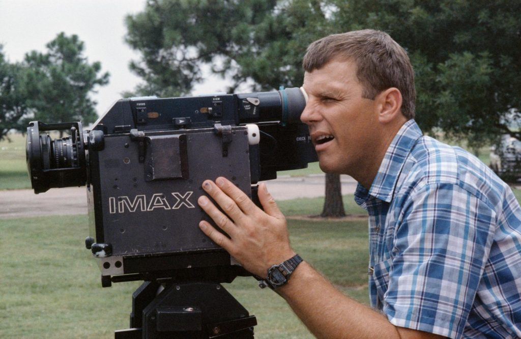 A cinematographer looking through the lens of an imax xamera